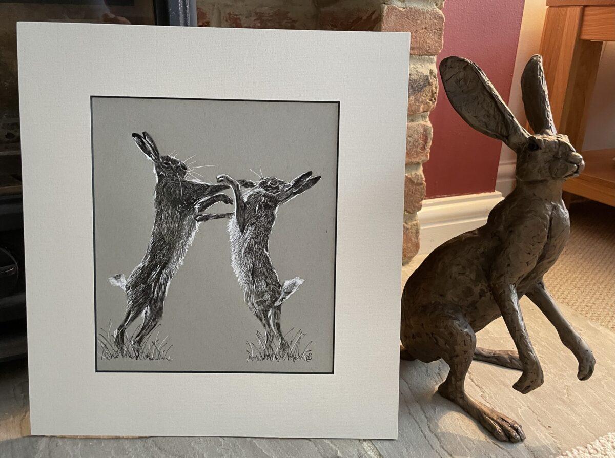 Original ink drawing of boxing hares