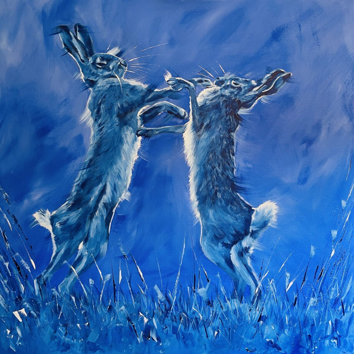 Large painting of boxing hares by North Yorkshire artist Vicki Davidson